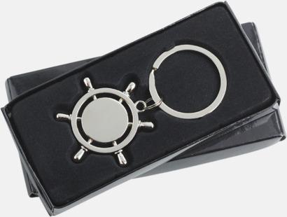 Nyckelring i form av en skeppsratt med egen gravyr