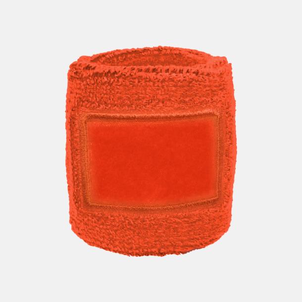 Orange Armsvettband med label att trycka på