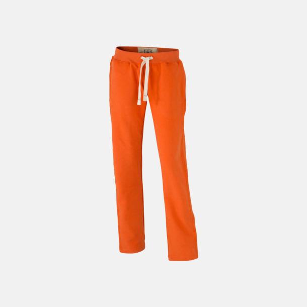 Dark Orange (dam) Färgglada mjukisbyxor i herr- och dammodell med reklamtryck
