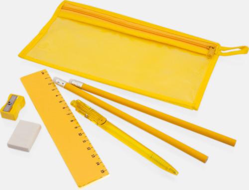 Pennskrin med pennor, linjal, vässare och sudd - med tryck