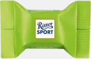 Nuts in Nougat Creme Ritter sport pralin på ett kort med reklamtryck