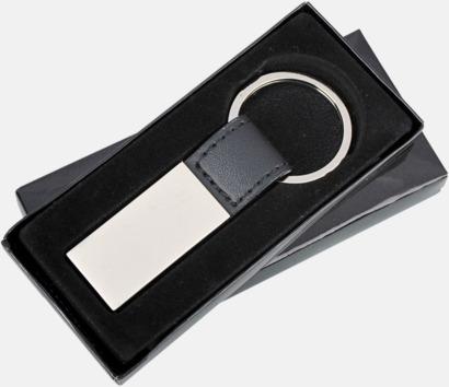 Nyckelringar av metall och läderimitation med egen lasergravyr
