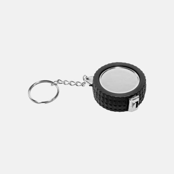 Svart/silver Måttband och nyckelring i form av ett däck