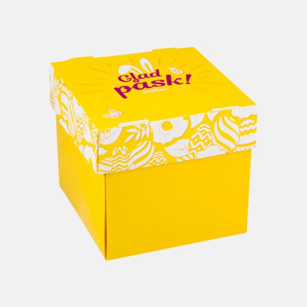 Gul Påskgodis i praktiskt ask som kan fällas ut till skål med eget tryck