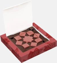 Rosa rubychoklad bitar med reklamtryck
