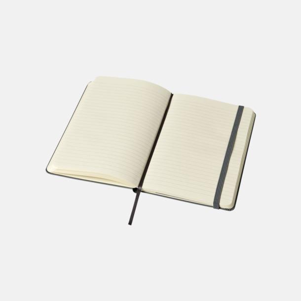 Linjerade sidor (ruled) Medelstora anteckningsböcker (ca B6) från Moleskine med reklamtryck