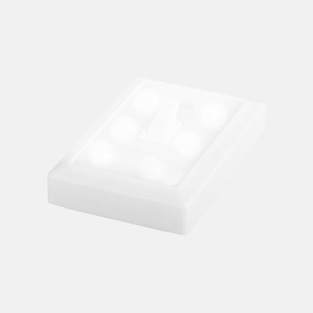 Lampa som ser ut som en strömbrytare med reklamtryck